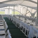 Marquee with tables laid out for a wedding reception