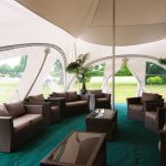 Comfortable seating area inside a marquee
