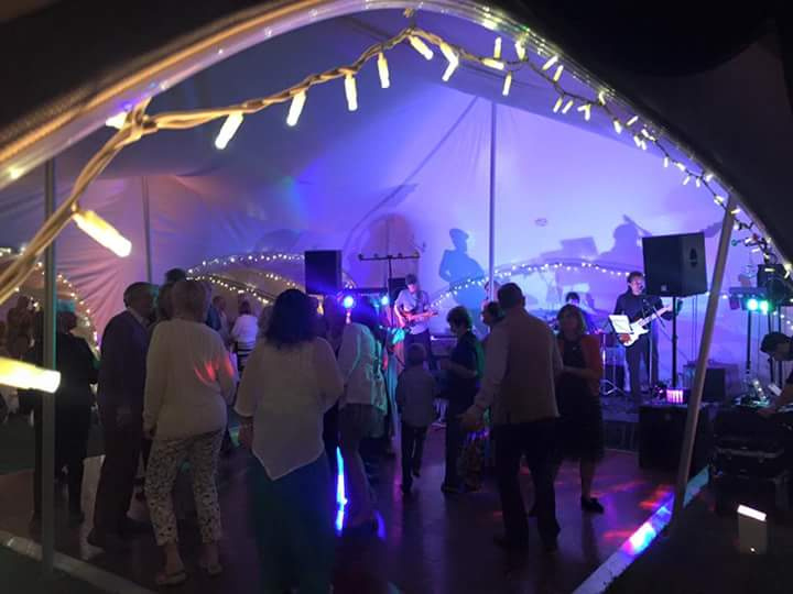 Party at night in a marquee