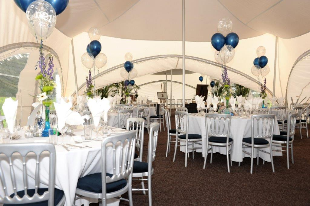 Beautiful blue and silver styled decor for a 21st birthday party in a amarquee