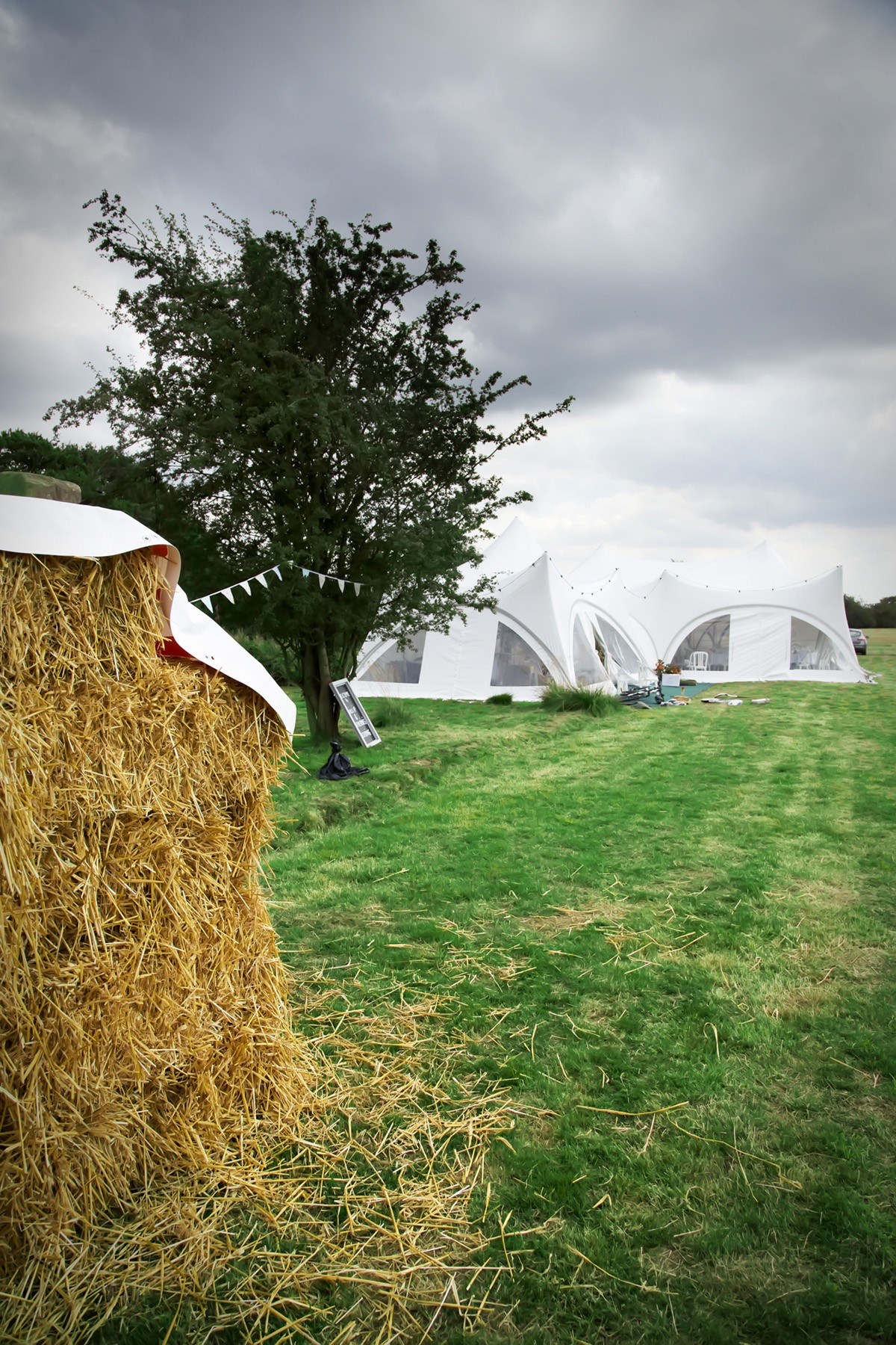 Straw bales and a marquee