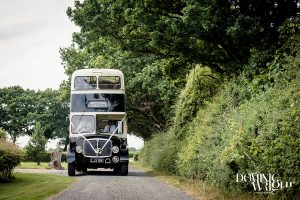 Black and white double decker bus decorated as wedding transport
