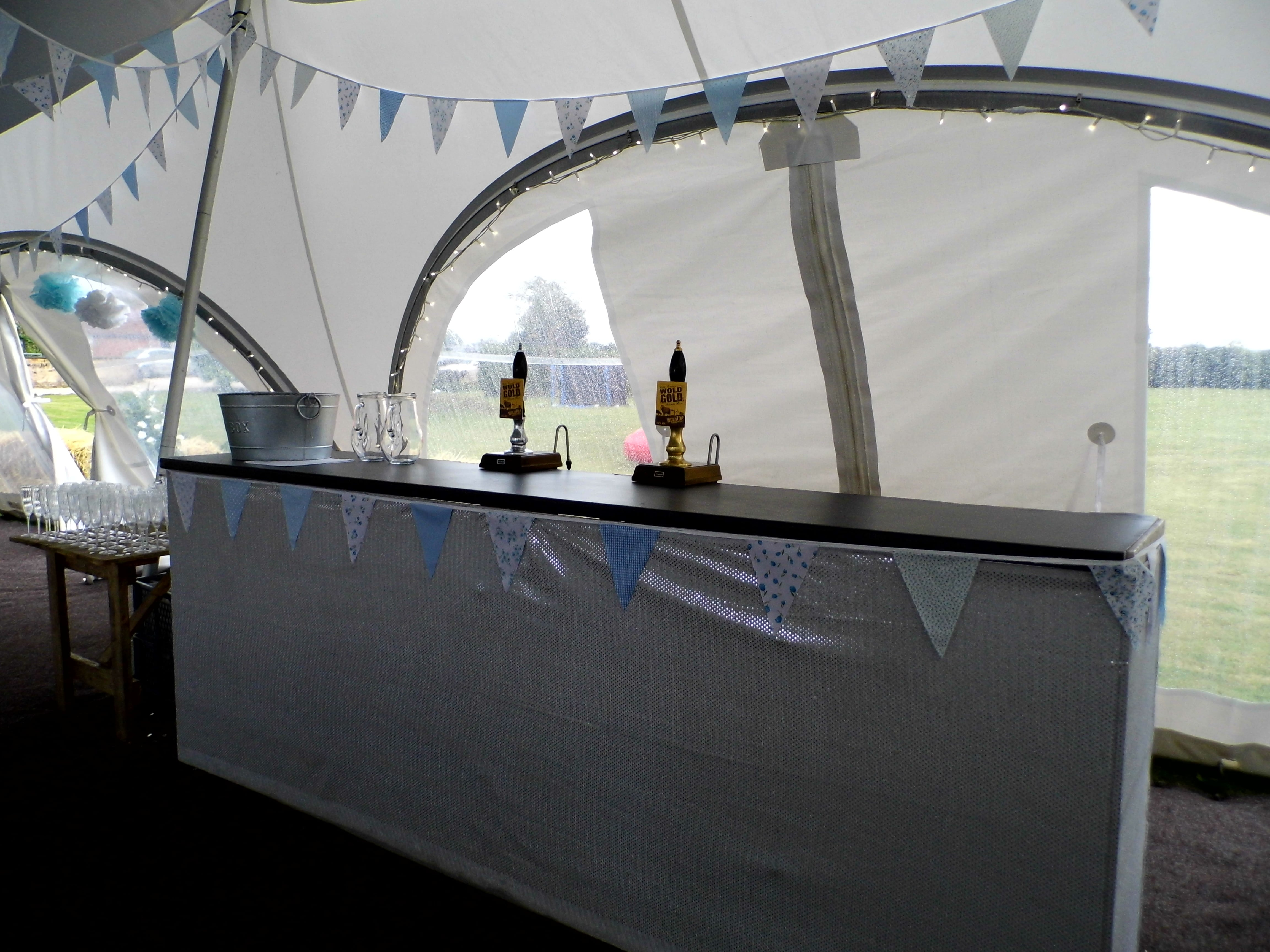 Bar in a marquee at a blue and white wedding