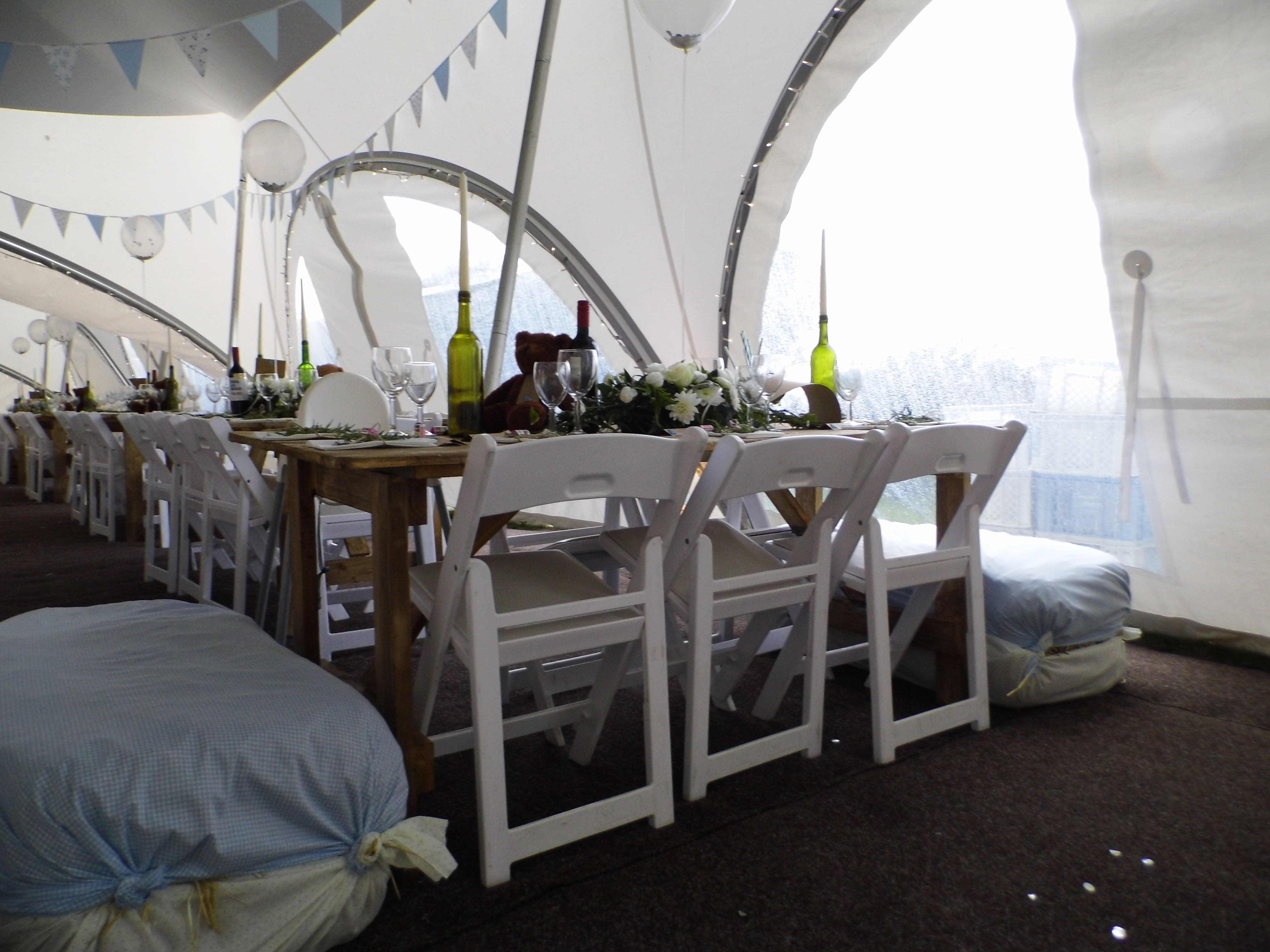 Tables set for a wedding in a marquee