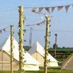 tented village at a rural wedding