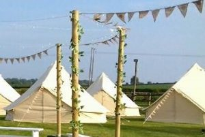 tented village at a rural wedding