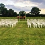 Ceremony area at Oak Tree Farm wedding venue, with coes watching on