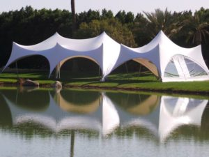 trapeze marquee by a lake